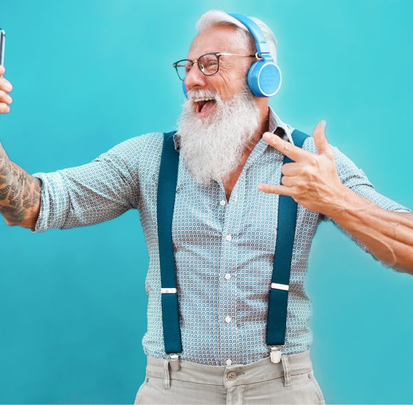 senior-hipster-man-using-smartphone-app-creating-playlist-with-rock-music